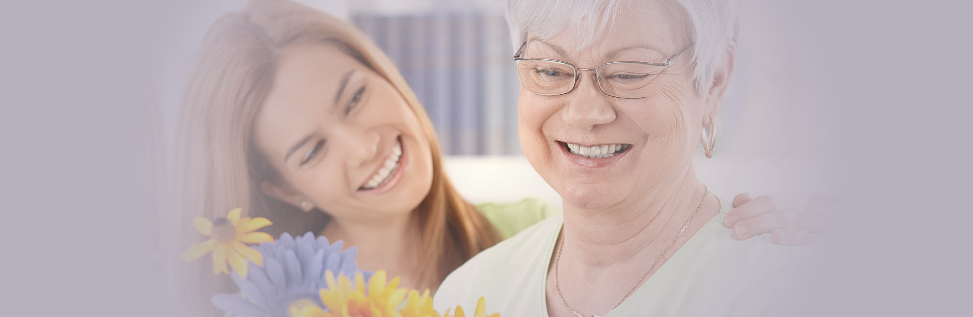 elderly woman and her daughter smiling together
